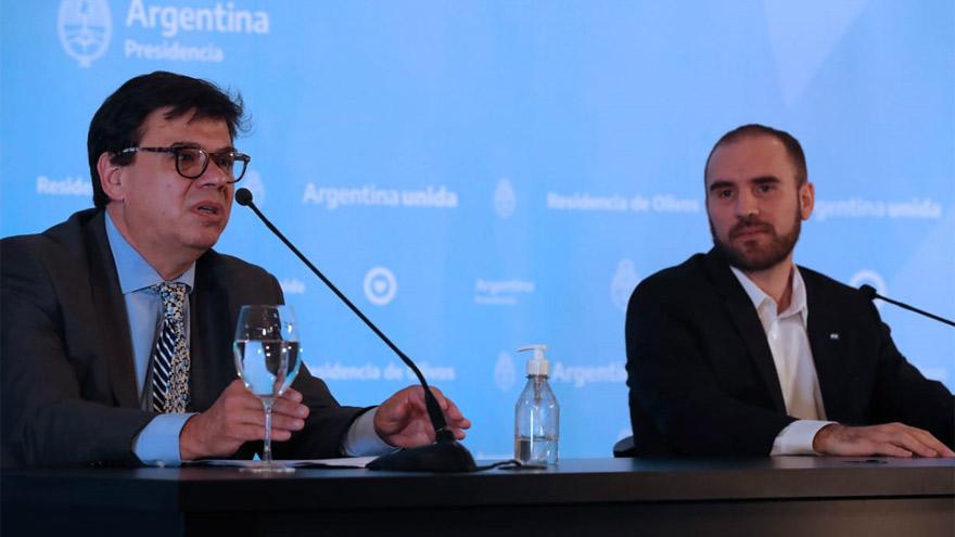 Claudio Moroni, encargado de llevar la noticia a los gremios, junto a Martín Guzmán.